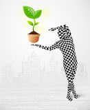 Man in full body suit with eco plant Royalty Free Stock Image