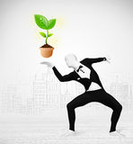 Man in full body suit with eco plant Stock Photo