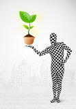 Man in full body suit with eco plant Royalty Free Stock Photos