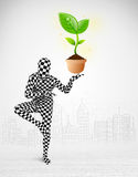 Man in full body suit with eco plant Stock Image