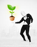 Man in full body suit with eco plant Royalty Free Stock Photo