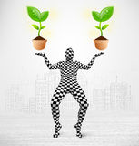 Man in full body suit with eco plant Royalty Free Stock Photography