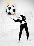 Man in full body suit holdig soccer ball Royalty Free Stock Photos