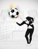 Man in full body suit holdig soccer ball Royalty Free Stock Images
