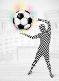 Man in full body suit holdig soccer ball Royalty Free Stock Photography
