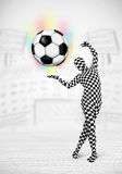 Man in full body suit holdig soccer ball Stock Photography