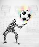 Man in full body suit holdig soccer ball Royalty Free Stock Image