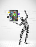 Man in full body suit holdig tablet pc Royalty Free Stock Photo