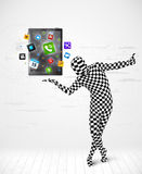 Man in full body suit holdig tablet pc Stock Photos