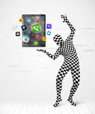 Man in full body suit holdig tablet pc Stock Image