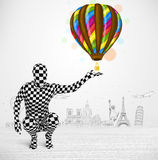 Man in full body suit holding balloon Royalty Free Stock Image