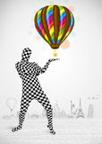 Man in full body suit holding balloon Royalty Free Stock Photos