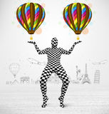 Man in full body suit holding balloon Royalty Free Stock Photo