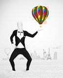 Man in full body suit holding balloon Stock Photos