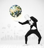 Man in full body suit holding planet earth Royalty Free Stock Photos
