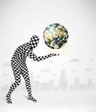 Man in full body suit holding planet earth Royalty Free Stock Photo