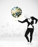 Man in full body suit holding planet earth Stock Image
