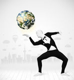 Man in full body suit holding planet earth Stock Images