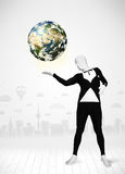 Man in full body suit holding planet earth Royalty Free Stock Images