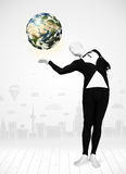 Man in full body suit holding planet earth Stock Photo
