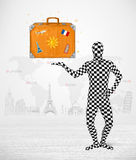 Man in full body suit presenting vacation suitcase Royalty Free Stock Photos