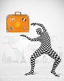 Man in full body suit presenting vacation suitcase Royalty Free Stock Images
