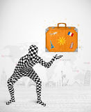 Man in full body suit presenting vacation suitcase Stock Photography