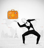 Man in full body suit presenting vacation suitcase Stock Image