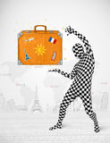 Man in full body suit presenting vacation suitcase Royalty Free Stock Photo