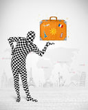 Man in full body suit presenting vacation suitcase Royalty Free Stock Image