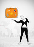 Man in full body suit presenting vacation suitcase Stock Photo