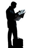 Man full length standing reading newspaper Stock Photography