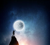 Man and full moon . Mixed media Stock Images