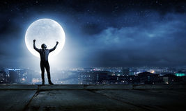 Man and full moon. Young man at night with big full moon at background Stock Photo