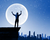 Man and full moon Royalty Free Stock Image