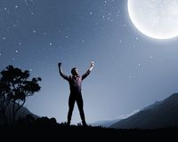 Man and full moon. Young man at night with big full moon at background Royalty Free Stock Images