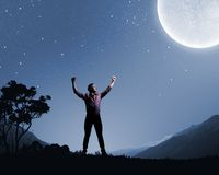 Man and full moon Stock Photos
