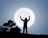 Man and full moon Royalty Free Stock Photography