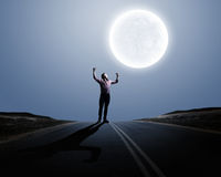 Man and full moon Stock Image