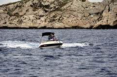 A man at full speed on a small boat Royalty Free Stock Photo