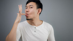 A man with full stomach. An Asian man just finished eating Royalty Free Stock Image