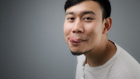 A man with full stomach. An Asian man just finished eating Royalty Free Stock Photos