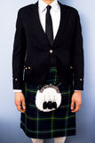 Man in full traditional Scottish kilt outfit. He is wearing a Campbell tartan Stock Images