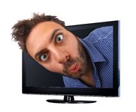 Man with funny expression jumping out of the TV, 3d effect royalty free stock photos