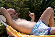 Man With Funny Expression Relaxing In The Garden Royalty Free Stock Photography