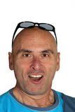 Man with funny face. Portrait of bald man with sunglasses and a funny facial expression Stock Images