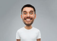 Man with funny face over gray background. Expression and people concept - smiling man with funny face over gray background (cartoon style character with big head Royalty Free Stock Photo