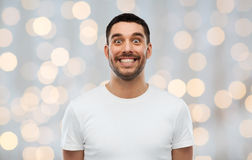 Man with funny face over lights background Royalty Free Stock Images
