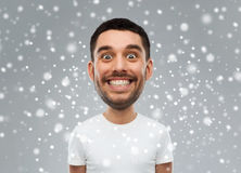 Man with funny face over snow background Royalty Free Stock Photos