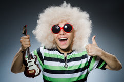 Man with funny haircut. And guitar Stock Photo